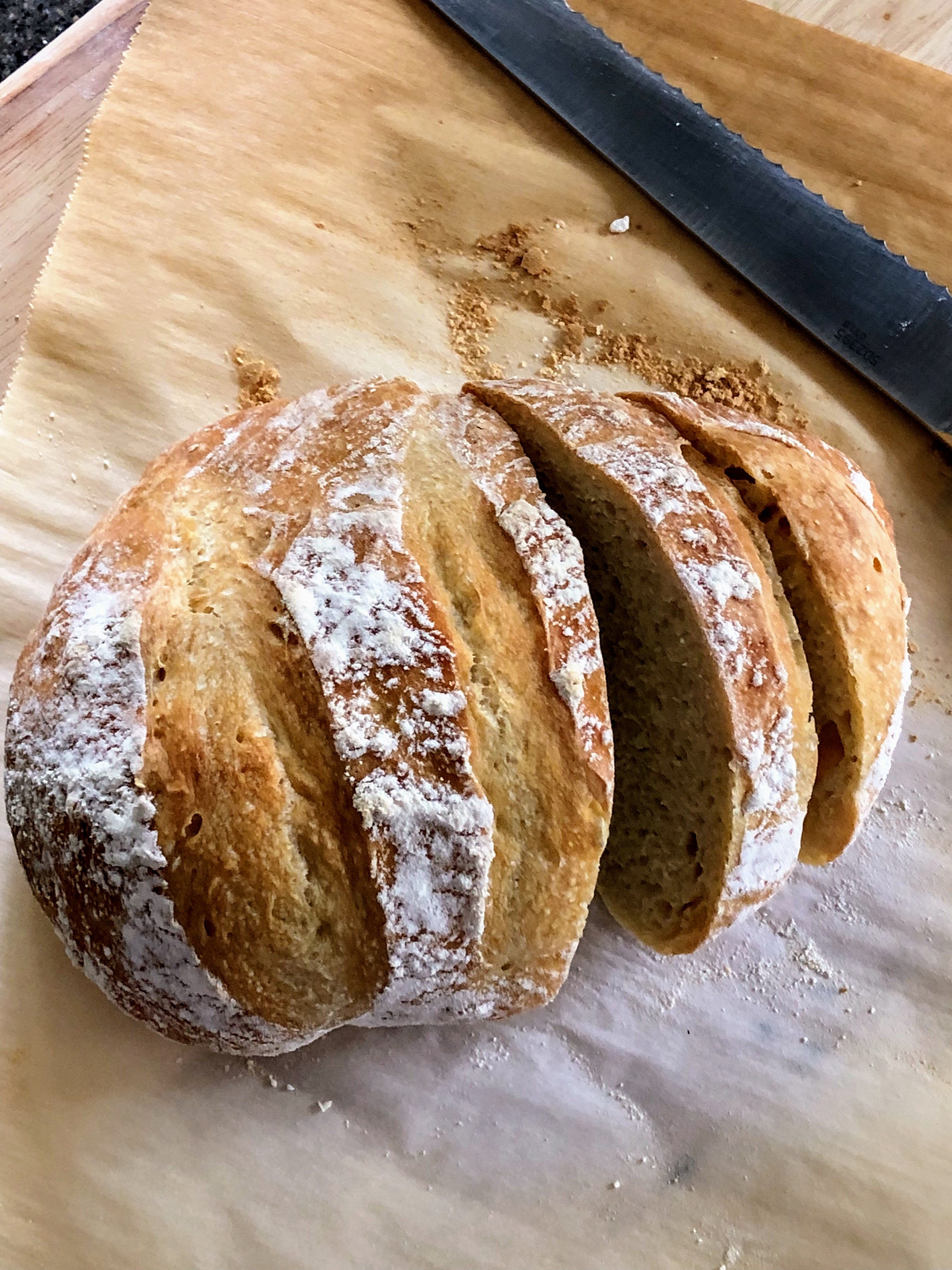 no knead bread on parchment cut in slices