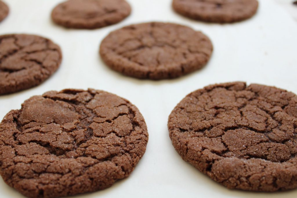 chocolate sugar cookies on parchment
