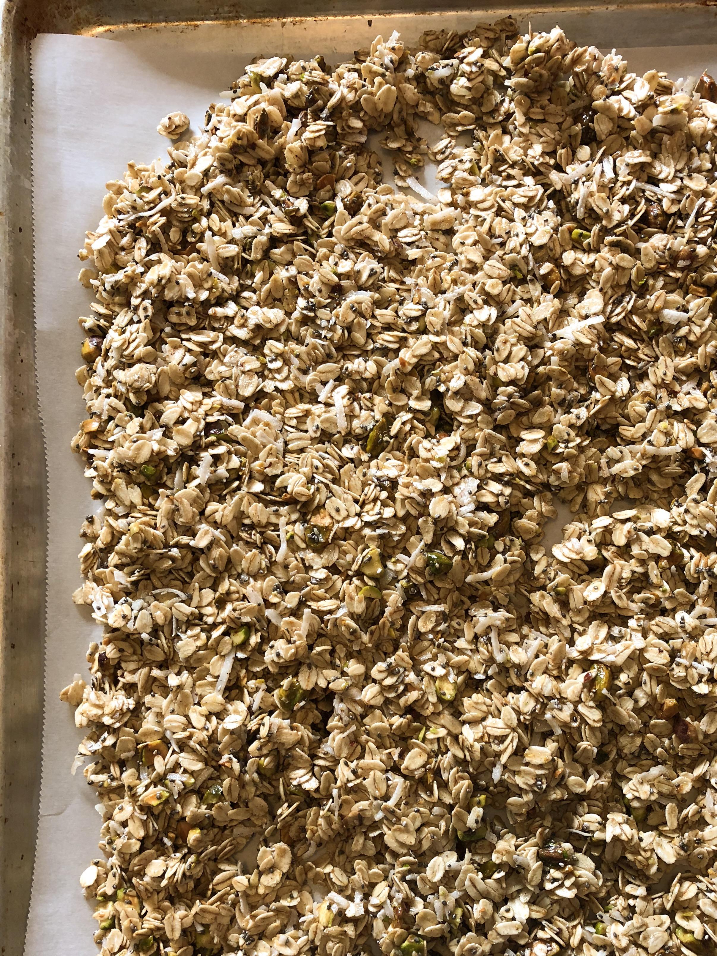 chai granola on parchment pan