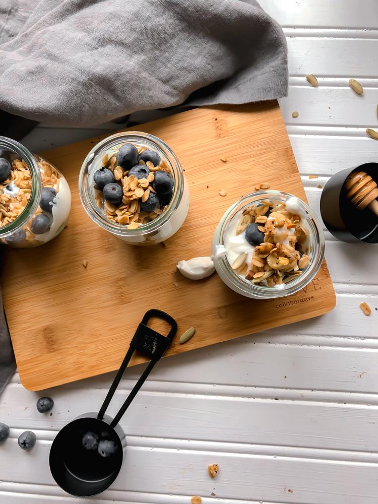 chai granola parfait overhead napkin wood board honey