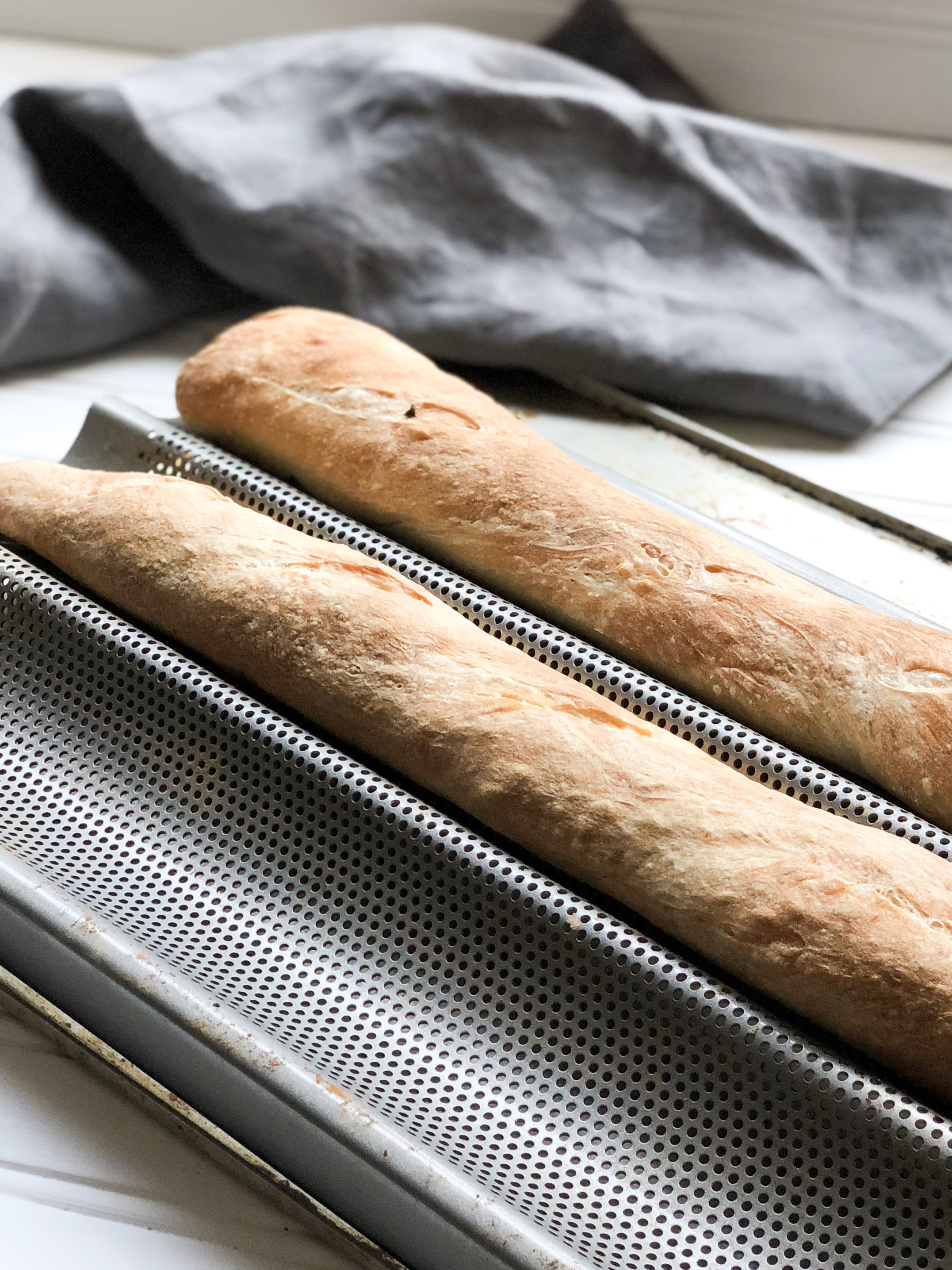 baguettes on pan with napkin