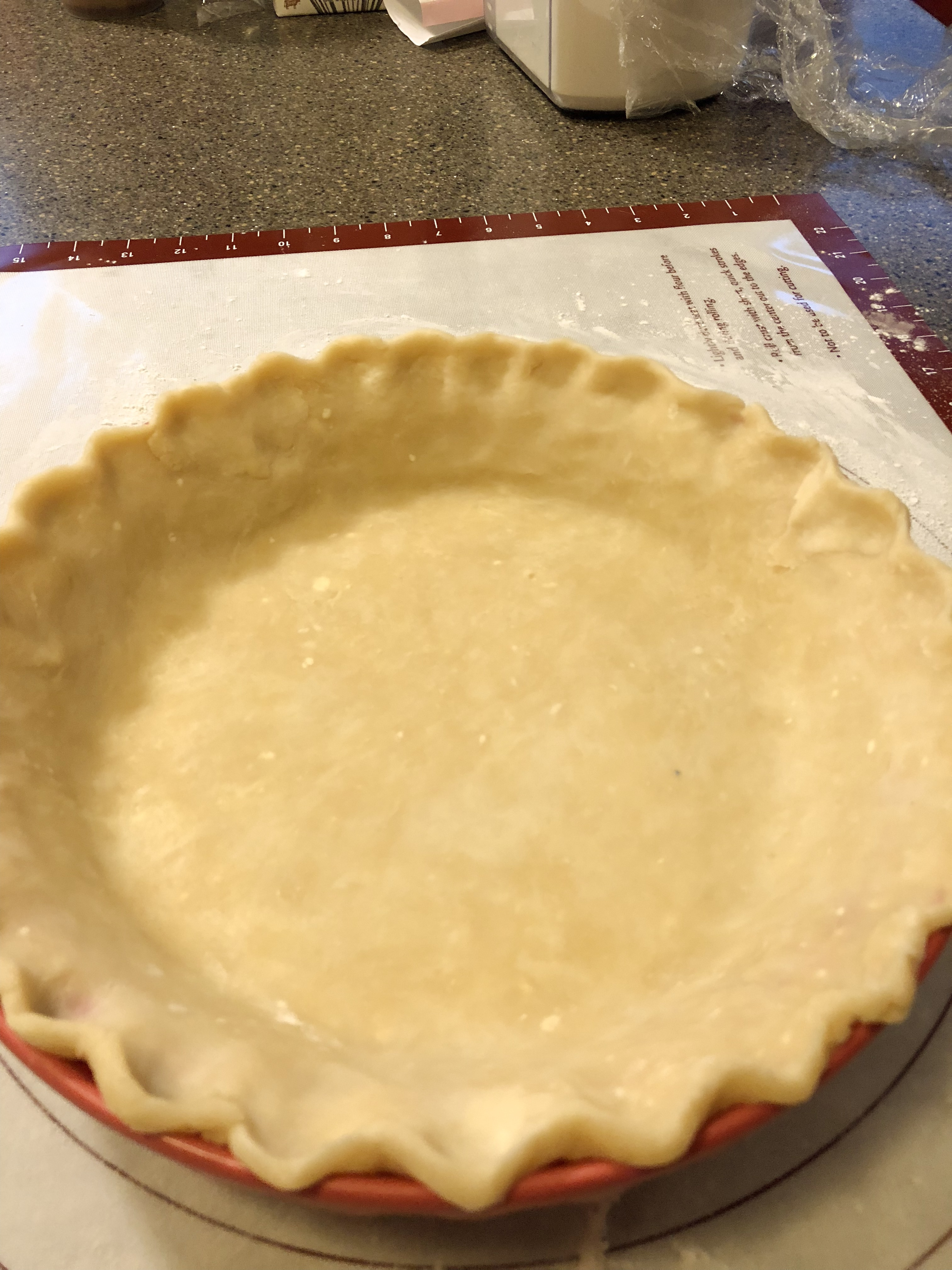 pie crust in pan with crimped edges