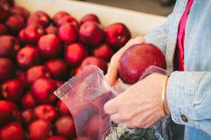 mom putting apple into bag