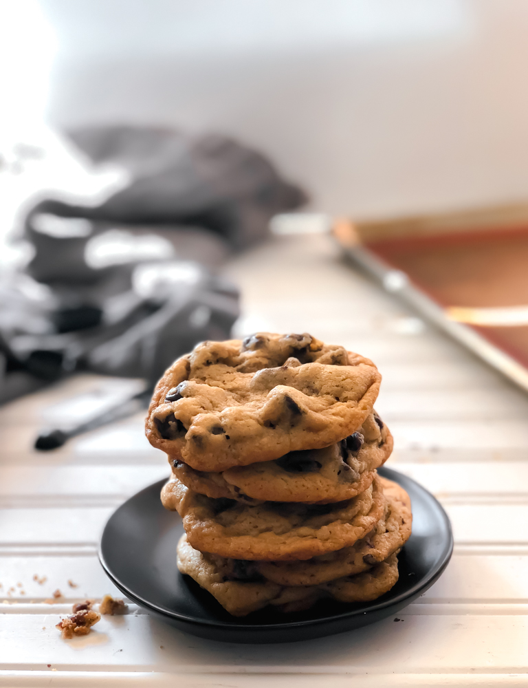 chocolate chip cookies stacked on a plate