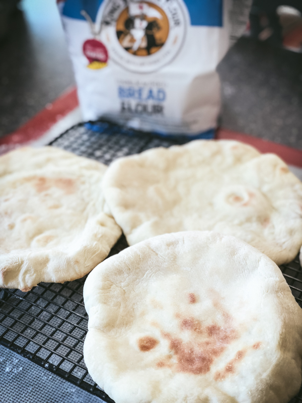baked pita bread on rack