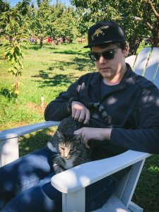 Rhodes with cat on lap