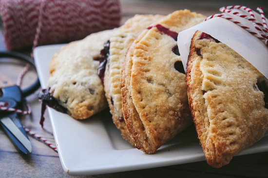 blueberry apple turnovers on white plate