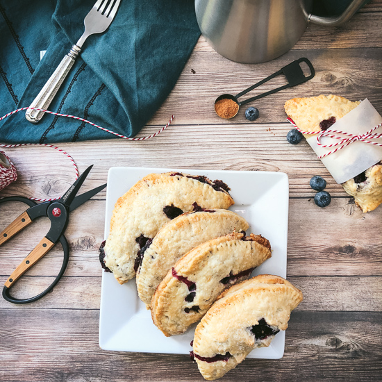 blueberry and apple turnovers overhead with scissors and cinnamon