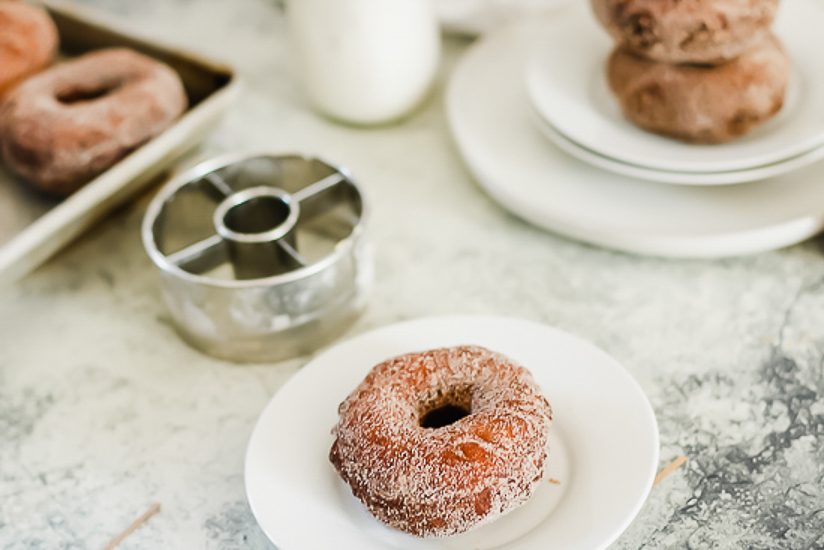pumpkin brioche doughnuts one on plate and donut cutter
