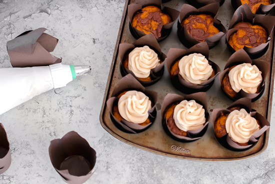 pumpkin nutella cupcakes in pan with frosting