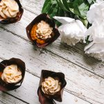 pumpkin nutella cupcakes overhead with flowers
