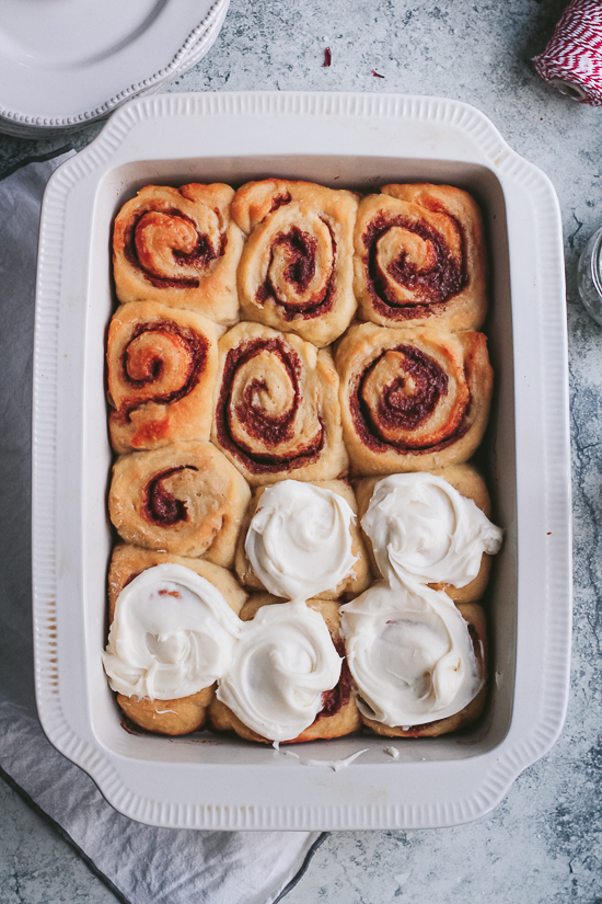 brioche cinnamon rolls in pan with frosting