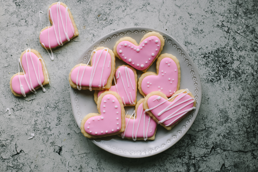 valentine heart sugar cookies pink on white plate