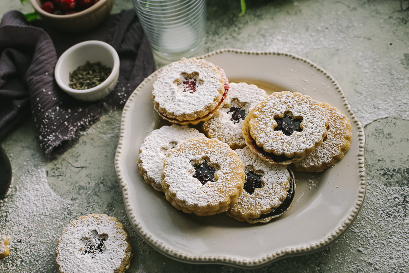 linzer cookies on plate with fillings