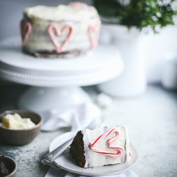 chocolate peppermint layer cake on stand and plate