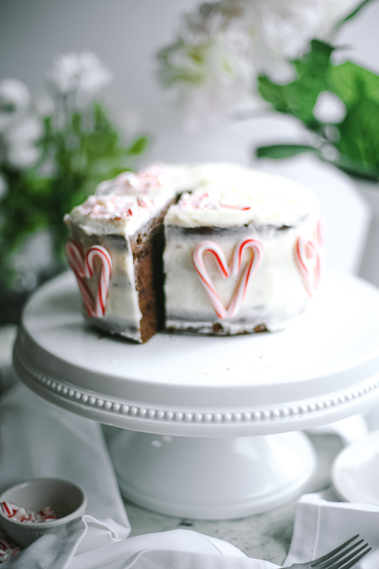 chocolate peppermint layer cake on white stand straight on