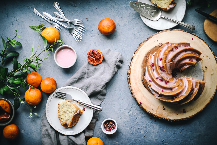 blood orange poppyseed bundt cake overhead with piece of cake