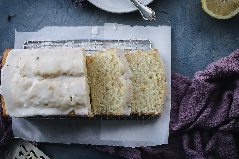 lemon pound cake with lemon lavender glaze overhead with slices