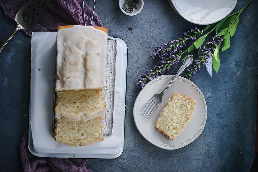 lemon creme fraiche pound cake with lemon lavender glaze overhead vertical