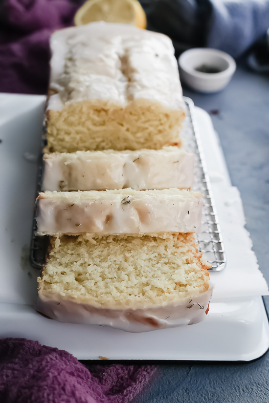 lemon pound cake with lemon lavender glaze front view with slices