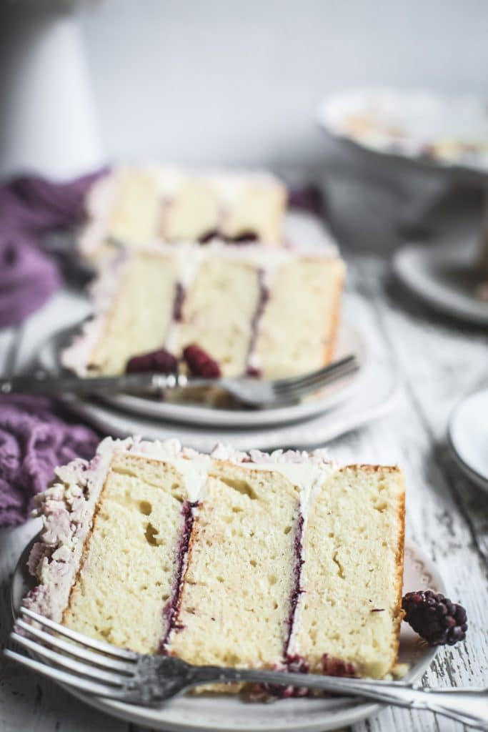 sliced marionberry lavender layer cake on plates