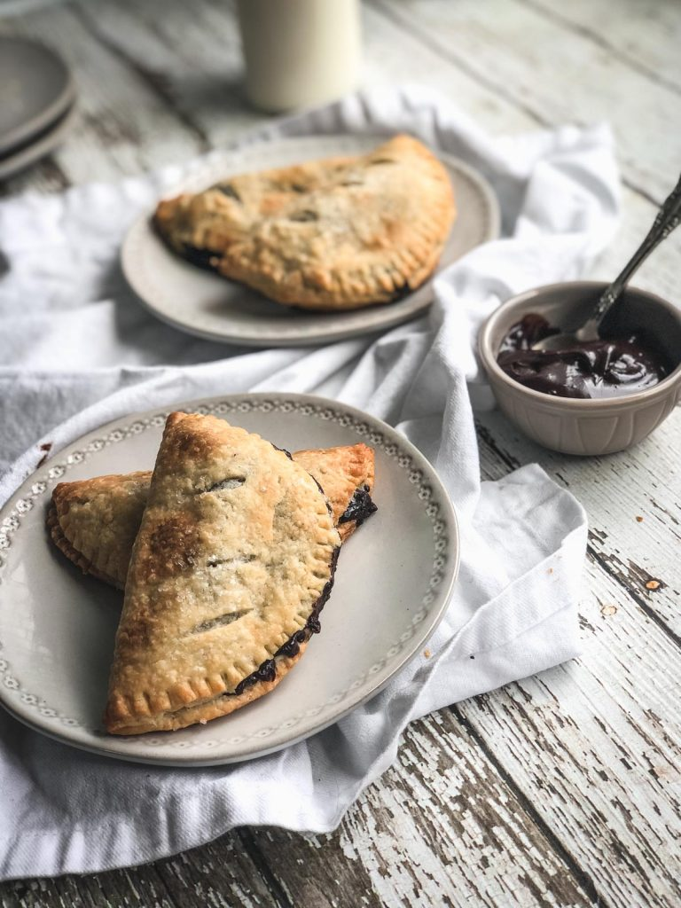 hand pies on plate with chocolate