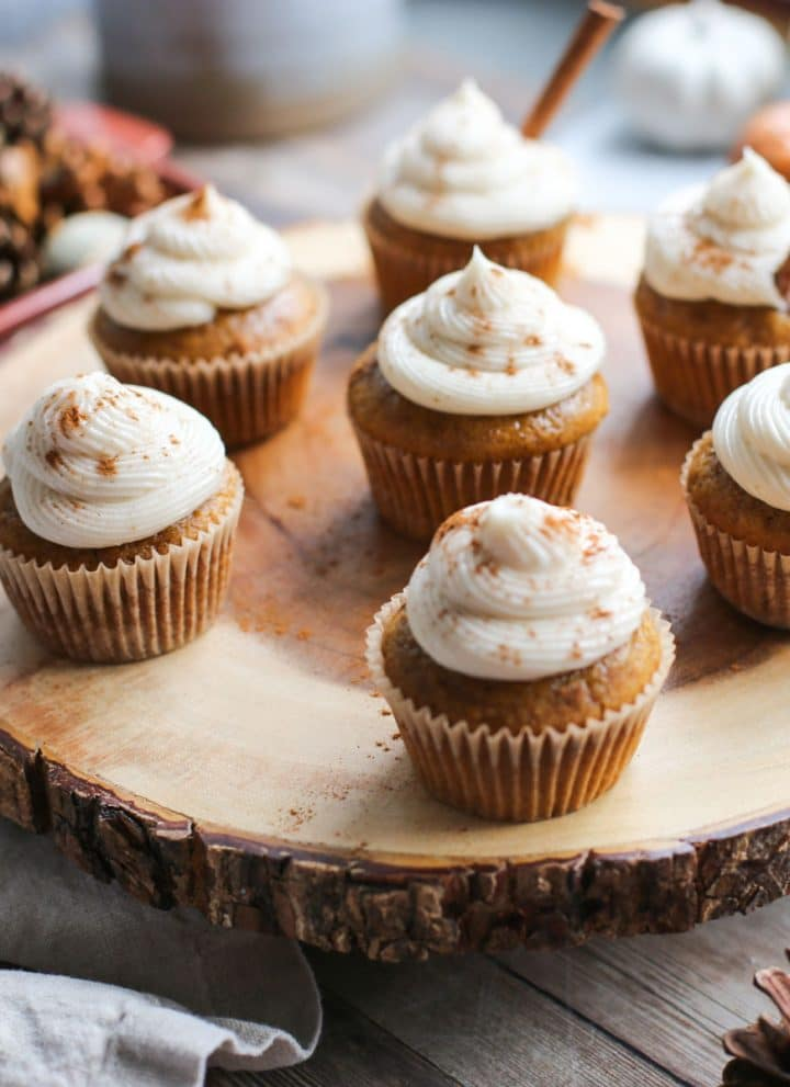 pumpkin cupcakes on wood tray