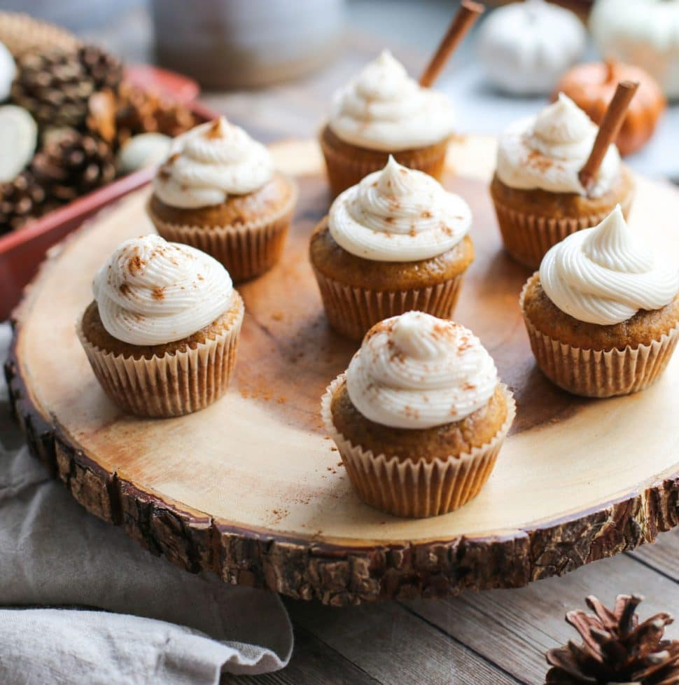 pumpkin cupcakes on wood tray