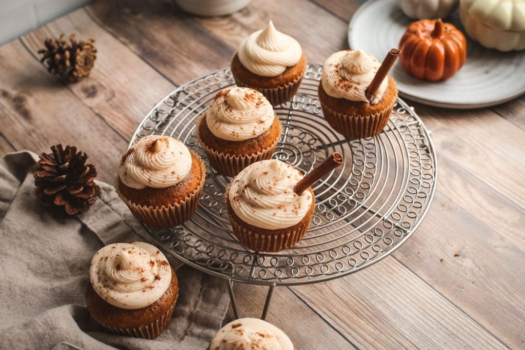overhead of pumpkin cupcakes on wire rack